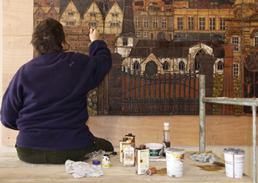 Philippa working on mural surface