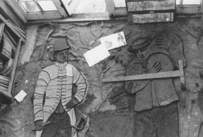 The only photo I have of the mural being made. Seen from the studio above gallery, two figures are being modelled up on the studio floor - a midshipman and mariner from the age of sail.  Hessian divides the raw clay from the cement beneath.  White slip (liquid clay) has been applied ready for the application of transparent glazes at a later stage.