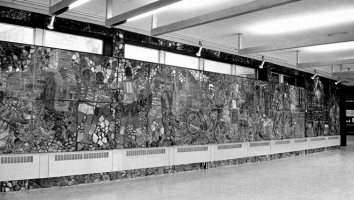 A large section of the long mural. Stones were used to cover the wall above the windows and beneath the radiators to give unity to the whole wall.