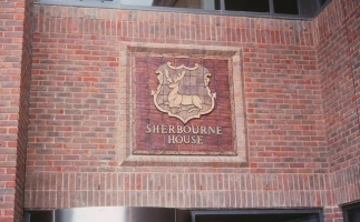 A stag watermark panel on Sherbourne House.