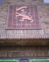 The Lion watermark panel on Siskin House.