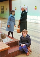 A bored looking young Daniel with sister and grandmother admiring the toads.