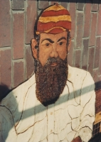 A close up of W. G. Grace in position on the building.