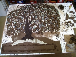 The background of the tree is cut away which leave spaces for the white stones at a later stage