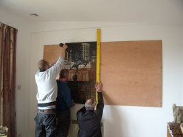 Workmen putting up the mural