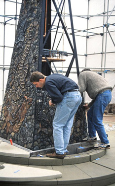 Fixing a panel to the obelisk