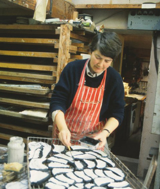 Glaze being applied to the clay