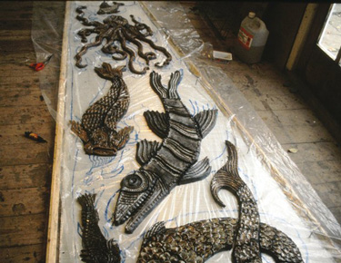 Glazed creatures laid out on polythene tracing