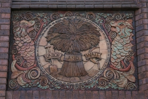 19th/20th Century - Corn Sheaf. The original symbol associated with the Cooperative Society. This building was erected on the site of the old Bristol Cooperative Society Headquarters.