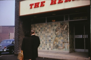 Wonderfully dated photo of the mural with name board in typical 60s typeface