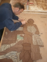 Cutting in the farm labourer into the rest of the modelled clay