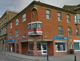 Image from Google Streetview (May 2014) showing the crest high up on the corner of the Co-Operative Bank.