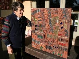 Philippa admires one of the nine panels now back at our workshops in December 2014.