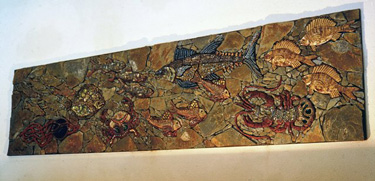 Mural with modelled and glazed fishes