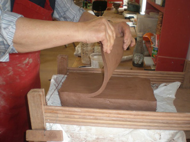 Cutting slabs of clay