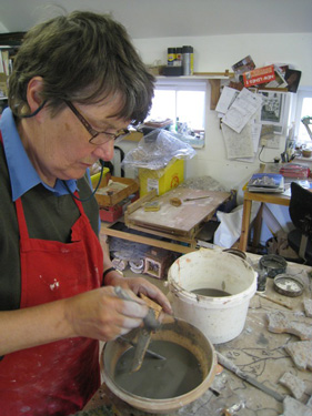 Philippa applying slip to biscuit fired piece